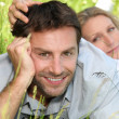 Stock Photo: Couple resting on grass