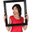 Stock Photo: Brunette red tunic holding frame