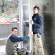 Stock Photo: Workers fitting double glazing