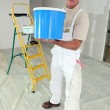 Stock Photo: Decorator with large pot of paint