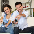 A couple having fun playing video games - Stock Photo