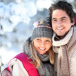 Portrait of happy couple at winter resort — Stock Photo