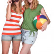 Two attractive girls holding inflatable beach ball — Stock Photo #9317346