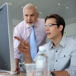 Young businessmen explaining point to boss — Foto Stock