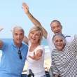 Foto Stock: Group of senior on beach