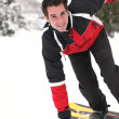 Iron mwith snowboard — Stock Photo #9318320