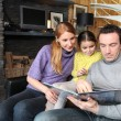 Parents reading a story to their daughter — Stock Photo #9318662