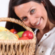 Royalty-Free Stock Photo: Woman holding fruit basket