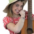 Playful girl holding guitar — Stock Photo