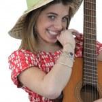 Playful girl holding guitar — Stock Photo
