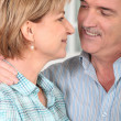 Senior couple embracing - Stock Photo
