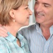 Stock Photo: Senior couple embracing