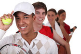 Four young illustrating different sports — Stock Photo