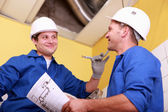Electricians exchanging views — Stock Photo