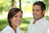 Man contemplating brown-haired woman — Stock Photo