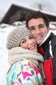 Couple enjoying their alpine getaway — Stock Photo