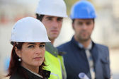 Three architect colleagues at construction site — Stock Photo