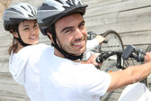 Couple on bicycle — Stock Photo