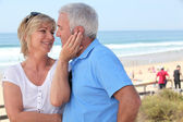 Couple on beach front — Stock Photo