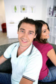 Couple back to back at home — Stock Photo
