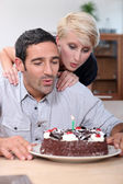 Couple blowing candle — Stock Photo
