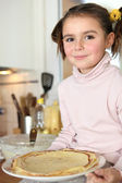 Little girl holding plate of pancakes — Stock Photo