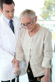Doctor with senior woman — Stock Photo