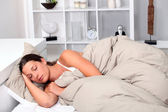 Woman asleep in bed — Stock Photo