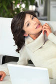 Brunette woman with computer — Stock Photo