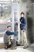 Workers fitting double glazing — Stock Photo