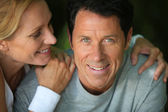 Middle-aged couple smiling — ストック写真