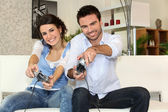 A couple having fun playing video games — Stock Photo
