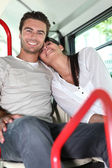 Couple on public transport — Stock Photo