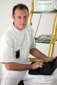 Tradesman ordering new parts online — Stock Photo