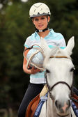 Young blond woman playing Horse ball — Stockfoto