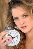 Woman rising late — Stock Photo