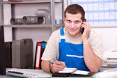 Plumbers' merchant taking a phone call — Stock Photo