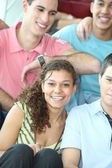 Group of teenage friends sat together — Stock Photo