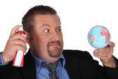 Angry man straying globe — Stock Photo