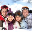 Two couples in a ski slope — Stock fotografie