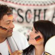 Couple of german soccer supporters — Stock Photo