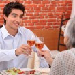 Grandmother and grandson at restaurant — Stock Photo