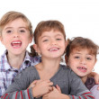 Studio portrait of three young siblings — Stock Photo