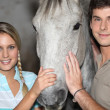 Teens with horse — Stock Photo #9320701