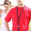 Woman with her personal trainer - Stock Photo
