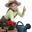 Stock Photo: Young girl gardening