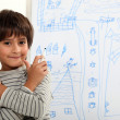 Child in front of blackboard drawings — Stock Photo #9321961