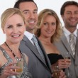 Men and women celebrating — Stock Photo