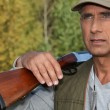 Stock Photo: Hunter with shotgun