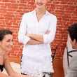 Waitress in a restaurant — Stock Photo